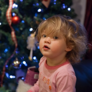 Violet taking a breather from opening gifts on Christmas day.