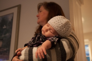 Scarlet sleeping in Nana Val's arms on Christmas day.