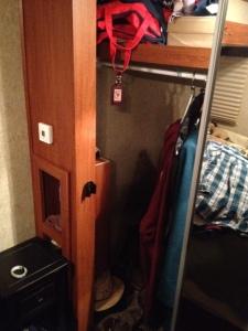 Left side of closet with intruding shelf unit.