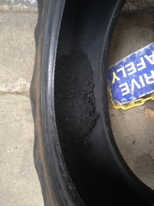 Huge glob of rubber inside the flat tire.