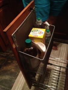 Basket mounted to door.