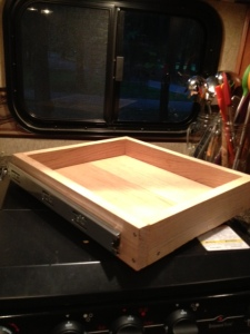 Finished drawer with rails mounted on it.