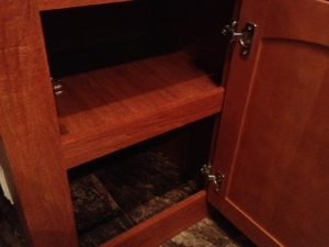 Shelf in cabinet.