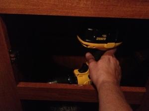 Removing the screws.