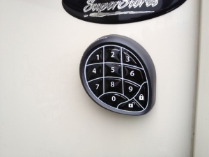 The outside keypad sticks on the outside wall.