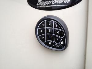 The outside keypad sticks on the outside wall.