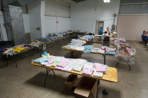 Multiple tables of baby items.