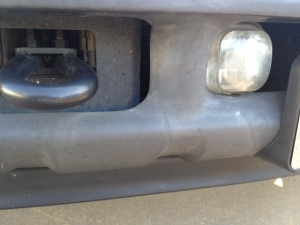 Before - trim under front bumper.