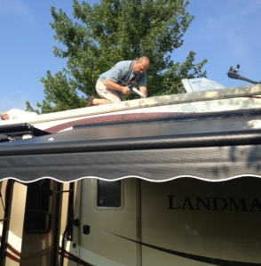 Jim Beletti and crew working on the roof of his coach