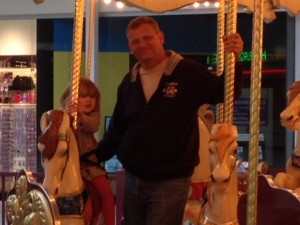 VIolet and Pa riding the carousel