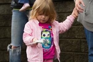 Violet feeding a budgie