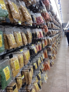Trail mix, candy and other snacks line one whole wall, all Buc-ee's branded.