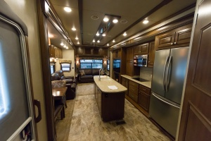 Looking towards the rear of the coach through the kitchen and into the living room.