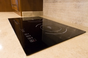 No gas stove here. A two burner induction cooktop and convection microwave make up the cooking appliances.