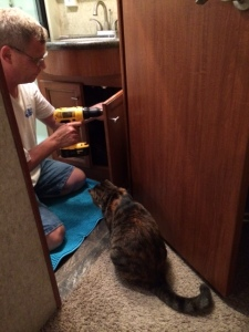 Callie supervises the lock installation