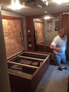 Pulling out things covering the carpet and wiring.