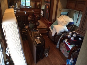 All the bedroom stuff in the living room and kitchen