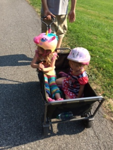 Violet and Scarlet riding in our wagon