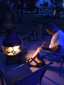 Sittin' by the fire, writin' post cards