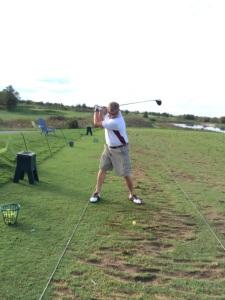 Malcolm taking a swing