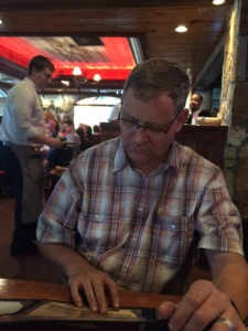 Malcolm pondering the menu at Saltgrass