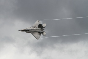 Dramatic clouds behind an F-22