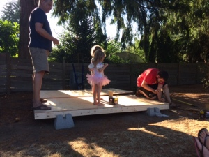 The deck going on (with help)