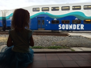 Scarlet watching a passing train at Trackside Pizza